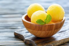 Homemade melon sorbet in a wooden bowl. Stock Photo