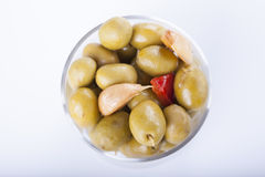 Bowl of homemade olives on a glass, typical spanish tapa, isolat Stock Images
