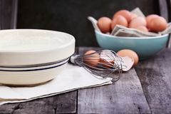 Pancake Batter Whisk and Fresh Eggs royalty free stock photography