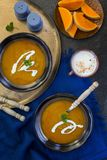 Roasted butternut squash and curry soup. A bowl of homemade Roasted butternut squash pumpkin and curry soup. Curried pumpkin soup royalty free stock photography