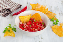 Bowl of  homemade salsa dip with chips. Royalty Free Stock Photography