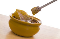Bowl of honey Royalty Free Stock Image