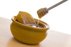Bowl of honey Royalty Free Stock Image