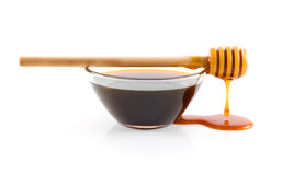 Bowl of honey Stock Images