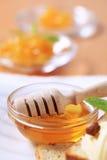 Bowl of honey Stock Image