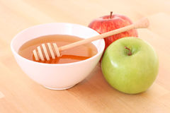 Bowl of honey and apple Stock Photo