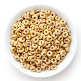 Bowl of honey cheerios isolated on white. Royalty Free Stock Photography
