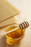 Bowl of honey and honeycomb in the background. Royalty Free Stock Photos