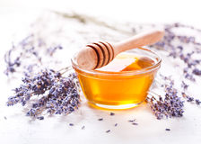 Bowl of honey and lavender flowers Royalty Free Stock Photography