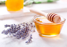 Bowl of honey and lavender flowers Royalty Free Stock Images