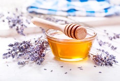 Bowl of honey and lavender flowers Stock Images