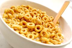 Bowl of honey loops Stock Photography