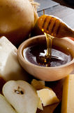 Bowl with honey and spoon Stock Photography