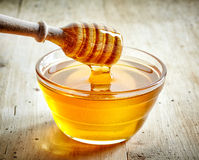 Bowl of honey. On wooden table stock photo