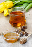 Bowl of honey on wooden table. Symbol of healthy living Stock Photos