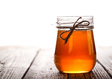 Bowl of honey on wooden table. Symbol of healthy living and natural medicine. Aromatic and tasty. Stock Photography