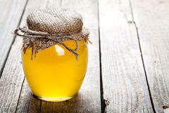 Bowl of honey on wooden table. Symbol of healthy living and natural medicine. Aromatic and tasty. Stock Images