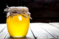 Bowl of honey on wooden table. Symbol of healthy living and natural medicine. Aromatic and tasty. Royalty Free Stock Photography