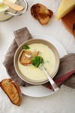 Bowl of hot cheese soup Stock Image