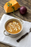 Bowl of hot pumpkin soup with cream Royalty Free Stock Images