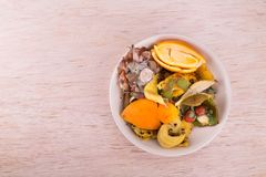 Bowl of household vegetable and fruits refuse collected for comp Stock Images