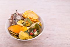 Bowl of household vegetable and fruits refuse collected for comp Stock Image