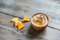 A bowl of hummus with corn chips Stock Photos