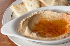 Bowl of hummus with olive oil and pita Stock Image