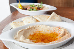 Bowl of hummus topped and salad Royalty Free Stock Photos