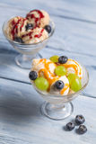 Bowl of ice cream with fruits Royalty Free Stock Images