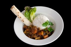 Bowl of Indian vegetable curry with rice and naan Royalty Free Stock Image