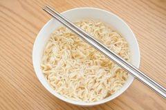 Bowl of instant noodles with chopsticks Royalty Free Stock Photo