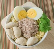 A Bowl of Instant Noodles with Meat Ball and Boiled Egg Stock Photo