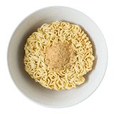 Bowl of Instant Noodles with Seasoning Powder on White. Cuisine and Food, Asian Ramen Dried Instant Noodles Blocks with Flavoring Powder for Cooked or Soaked in Stock Photo