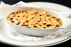 Bowl of Italian lasagne with cheese topping Royalty Free Stock Photos