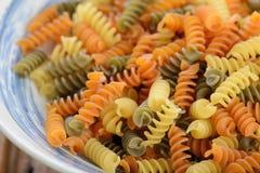 A bowl of Italian raw fusilli pasta Stock Image