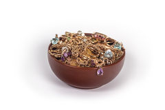 Bowl with jewelry and gold coins Royalty Free Stock Photo