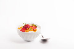 Bowl of jogurt and strawberiies. On a white backfround stock photography