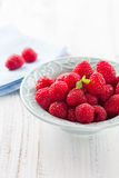 Bowl of juicy raspberries Royalty Free Stock Image