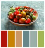 Bowl with juicy tomatoes on wooden table. Natural color palette for interior or fashion design. And art stock images