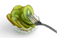 Bowl of kiwi with fork Stock Photo