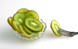 Bowl of kiwi with fork to the side Royalty Free Stock Photo