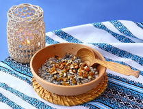 Bowl with kutia – traditional ritual slavic Christmas sweet me. Traditional lean porridge from a wheat, poppy, nuts and honey, which is cooking in eve Stock Images