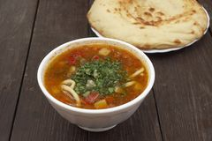 Bowl of  lagman pasta soup with  fresh-baked bread Stock Photos