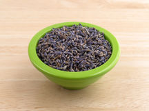 Bowl of lavender flower petals on table royalty free stock photos