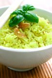 A bowl of lemon flavoured fragrant rice. With tasty cashew and herbs, garnished with a sprig of basil Royalty Free Stock Photos
