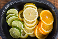Bowl with lemon, lime and orange. Slices stock image