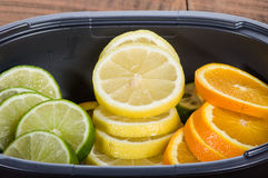 Bowl with lemon, lime and orange. Slices royalty free stock photography