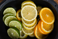 Bowl with lemon, lime and orange. Slices royalty free stock image