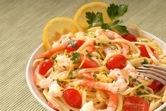 Bowl of lemon pasta and shrimp Stock Images